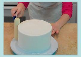 Learn how to smooth crusting buttercream with a paint roller in this member cake video tutorial on MyCakeSchool.com!