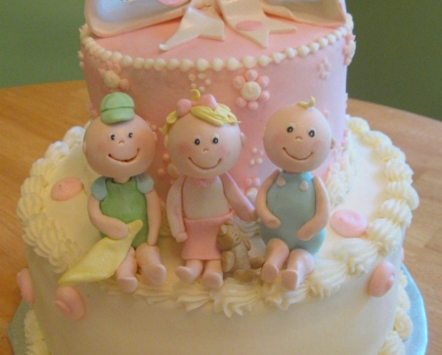 Learn how to model cute baby cake toppers for your baby shower cakes! MyCakeSchool.com.