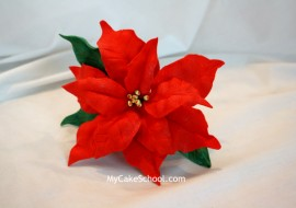 Learn how to make a gorgeous gum paste poinsettia in this My Cake School video tutorial!