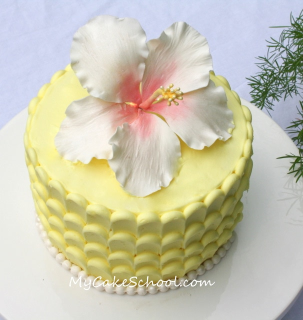 Learn how to make an elegant hibiscus from gum paste in this My Cake School video tutorial!