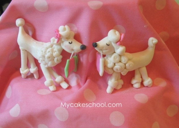 Learn how to make an adorable poodle from gum paste in this My CakeSchool cake decorating video tutorial!