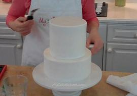 Learn the Basics of Tier Stacking in this Member Cake Video Tutorial from MyCakeSchool.com!
