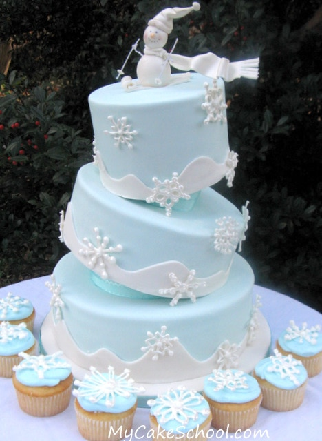 Learn how to make a tilted cake in this snowman themed My Cake School video!