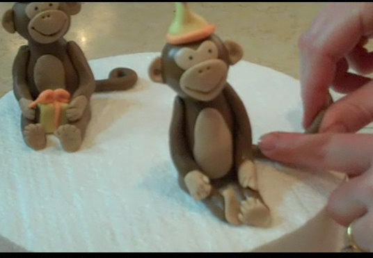 Learn how to make a CUTE monkey cake topper in this My Cake School cake decorating video tutorial!