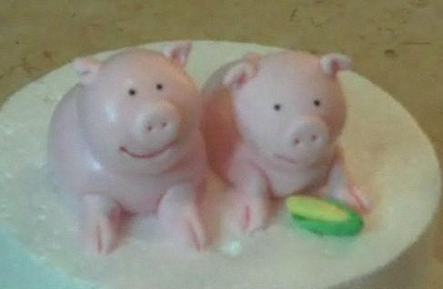 Learn how to make pig cake toppers from gum paste in this My Cake School cake decorating video tutorial!
