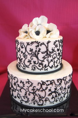 Learn the art of piped buttercream scrollwork in this MyCakeSchool.com cake video tutorial.