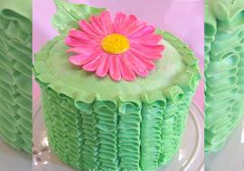 Learn how to make beautiful ruffled buttercream in this free cake buttercream cake tutorial by MyCakeSchool.com!