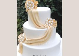 Leran to create elegant Fondant Draping in this Member Cake Video Tutorial by MyCakeSchool.com