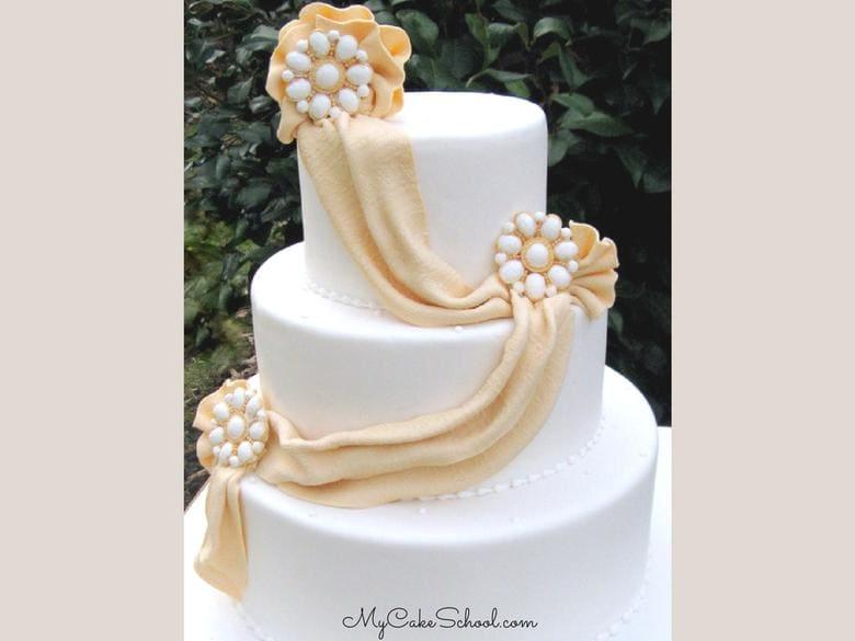 Leran to create elegant Fondant Draping in this Member Cake Video Tutorial by MyCakeSchool.com