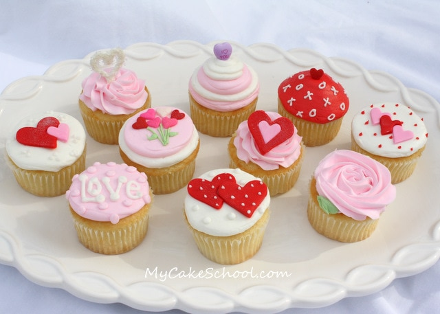 Adorable Valentine's Day Cupcake Tutorial! Choose from a variety of simple cupcake designs, and also learn how to create buttercream with a smooth finish using the Viva Paper Towel Method of smoothing!