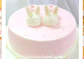 Free Cake Tutorial! Adorable Bunny Baby Booties Cake Topper, perfect for baby shower cakes!