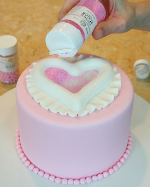 Beautiful Raised Heart Cake Tutorial! Perfect for Valentine's Day! Free tutorial by MyCakeSchool.com.