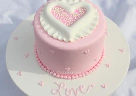 Simple and Sweet Raised Heart Valentine's Day Cake Tutorial! Free step-by-step tutorial by MyCakeSchool.com.