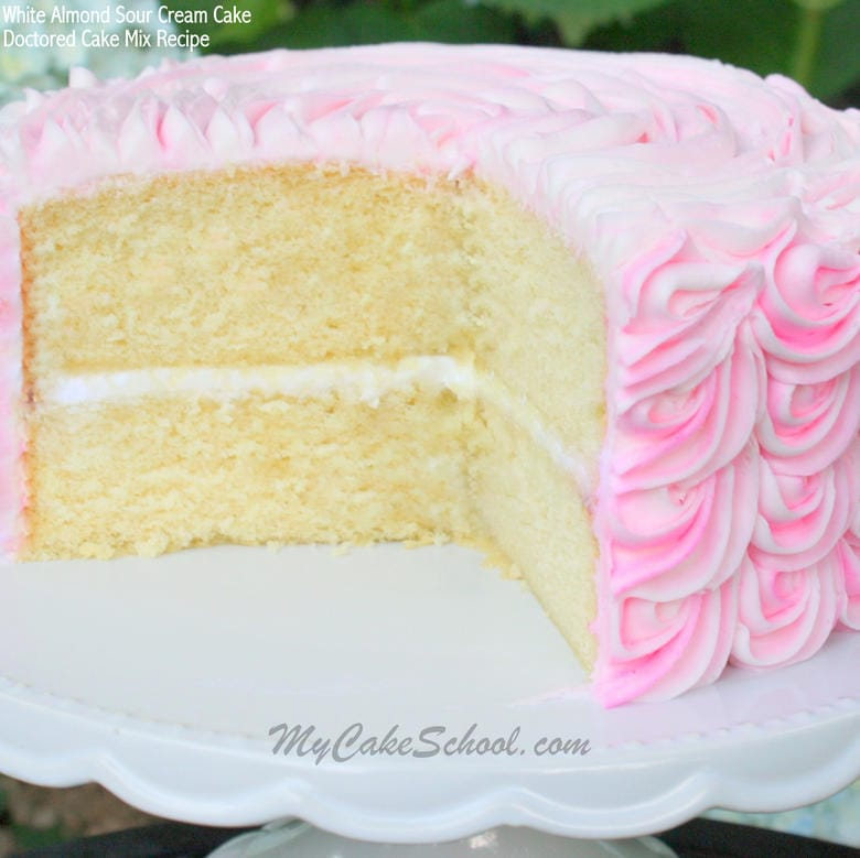 Delicious and Simple White Almond Sour Cream Cake (Doctored Cake Mix) Recipe! So moist and delicious! MyCakeSchool.com.