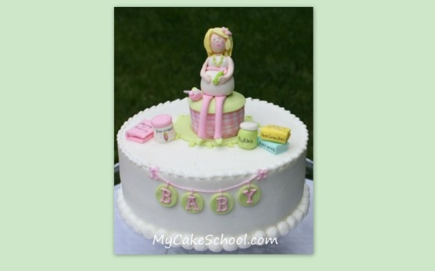 "Learn to make this adorable mommy-to-be cake topper as well as this cute ""Pickles and Ice Cream"" themed baby shower cake in MyCakeSchool.com's cake decorating member video library."