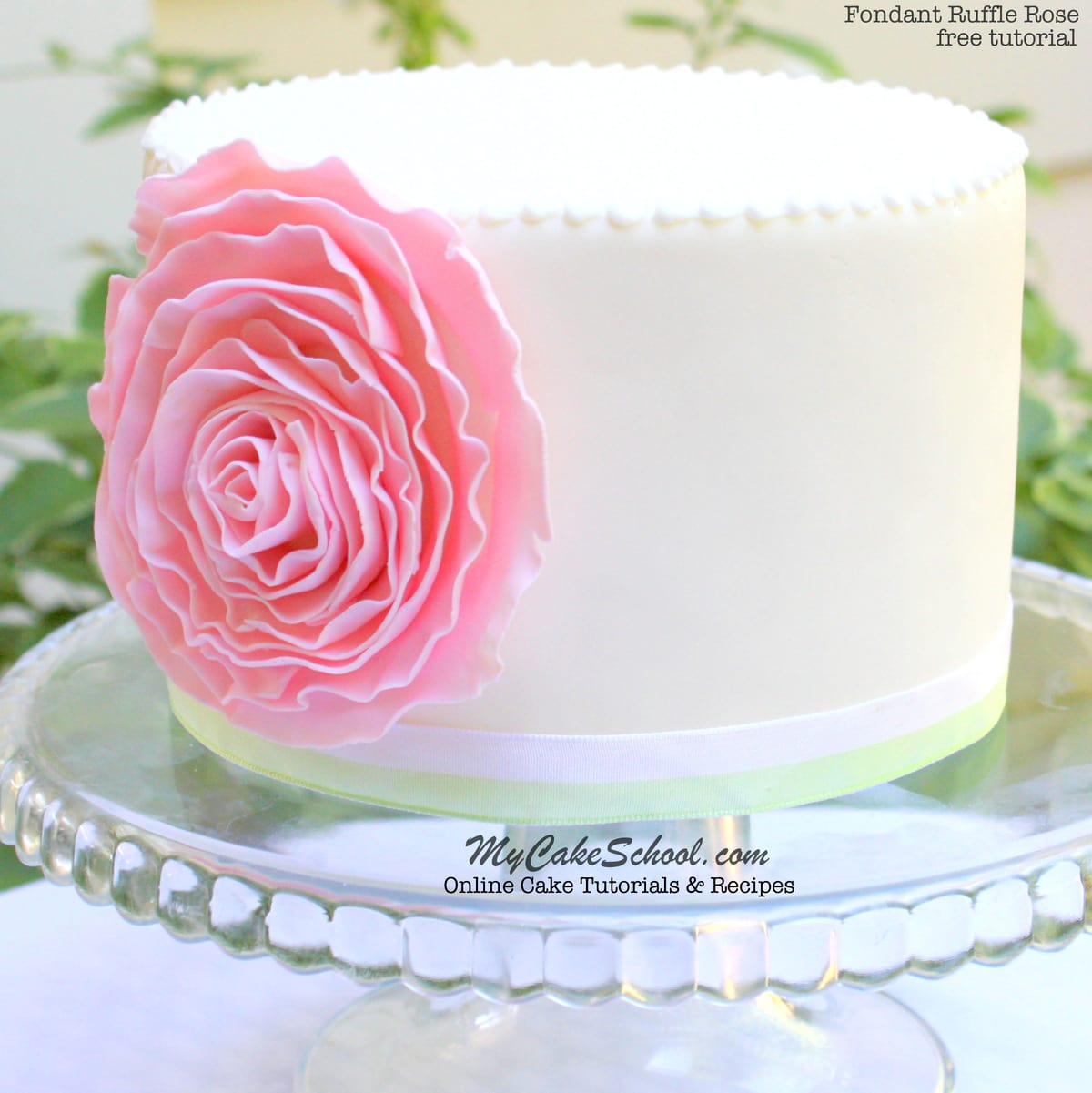 Learn how to make an elegant Fondant Ruffle Rose Cake in this free step by step cake tutorial by MyCakeSchool.com!