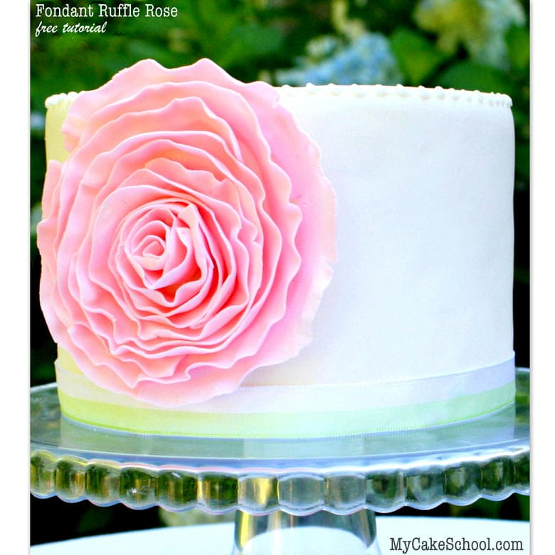 Free tutorial for a BEAUTIFUL fondant ruffle rose cake! MyCakeSchool.com.