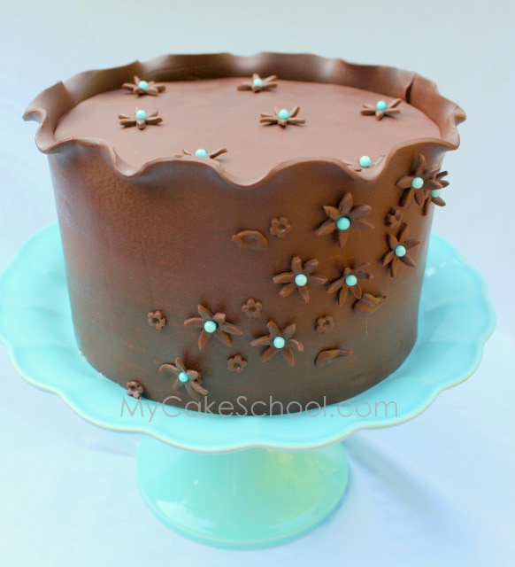 Learn to create a Beautiful Modeling Chocolate Wrap! MyCakeSchool.com Member-Cake-Tutorial. MyCakeSchool.com Online Cake Tutorials, Videos, & Recipes!!