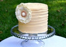 In this My Cake School cake video, learn to create a Shabby Chic Ruffled Flower on Textured Buttercream!