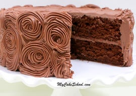 This fabulous Chocolate Cake Recipe starts with a cake mix! Quick, easy, and super moist. MyCakeSchool.com Online cake recipes, tutorials, videos, and more!