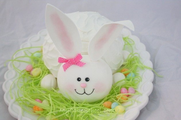 Adorable Bunny Cake Tutorial by My Cake School! Free step by step cake decorating tutorial. MyCakeSchool.com Online Cake Tutorials, Cake Videos, Cake Recipes, and more!