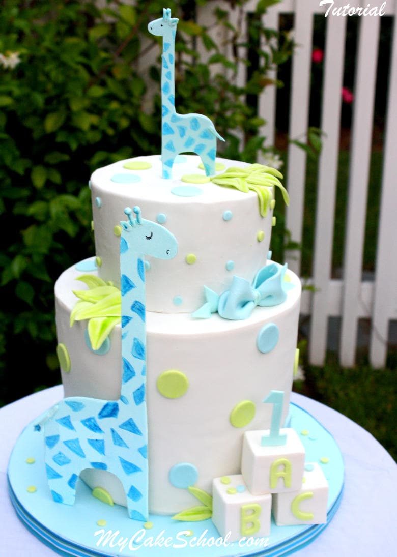 Learn how to make a double barrel cake and sweet giraffes in this MyCakeSchool.com video! Perfect for young birthdays and baby showers! MyCakeSchool.com.