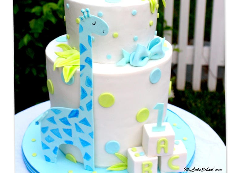 Learn how to make a double barrel cake with sweet giraffes in this MyCakeSchool.com video tutorial! Perfect for young birthdays and baby showers! MyCakeSchool.com.