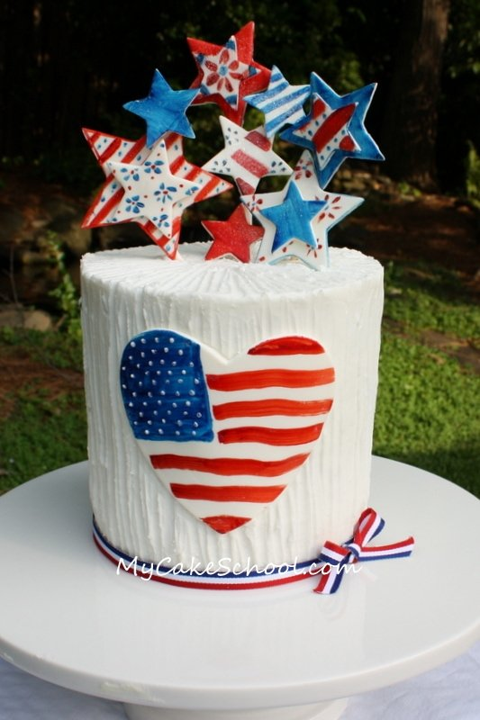We Heart America! A free step by step cake tutorial with hand painted accents! Perfect for July 4th! MyCakeSchool.com.