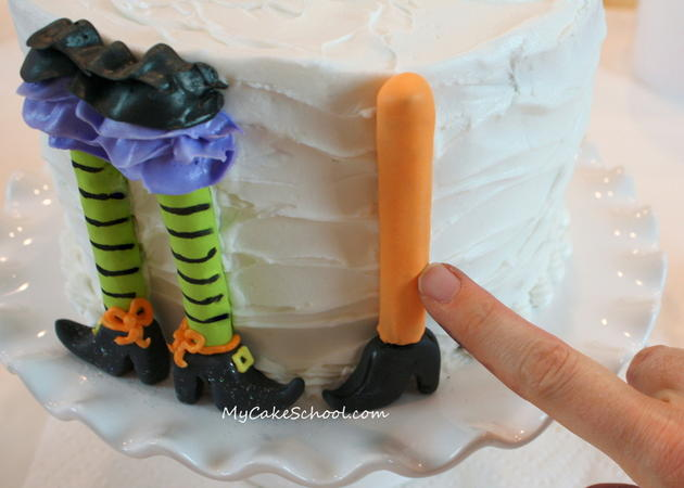 Free Tutorial for a CUTE Halloween Party Cake featuring witch legs and brooms! So fun and festive! MyCakeSchool.com