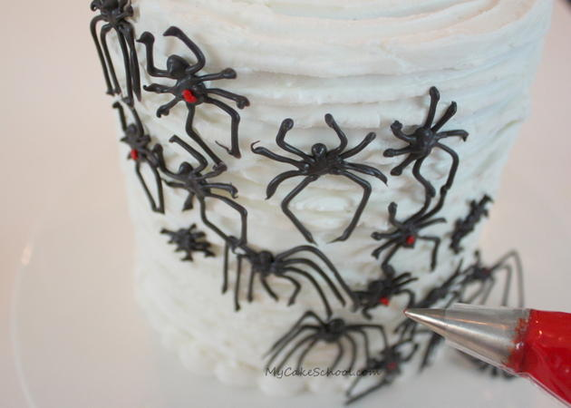 Learn how to make creepy chocolate spiders in this free Halloween cake tutorial by MyCakeSchool.com!