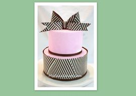 Learn how to make a modern chocolate wrap and chocolate bow in this My Cake School video tutorial!