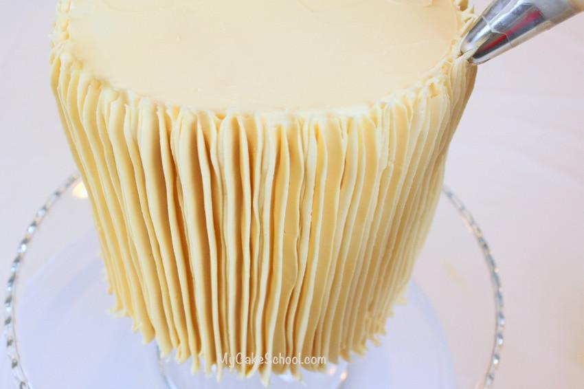 Pipe vertical ridges of buttercream! Cool effect- MyCakeSchool.com