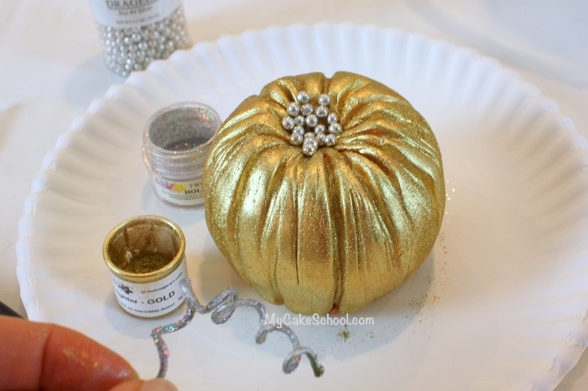 Learn how to make gorgeous pumpkin cake toppers in this free tutorial by MyCakeSchool!