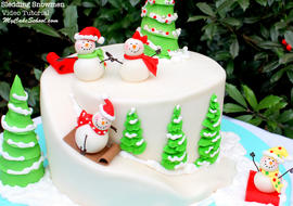 Sledding Snowman Cake! An adorable cake design for Christmas or winter. Tutorial by MyCakeSchool.com!