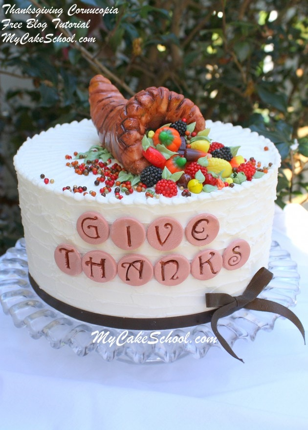 We love this simple Thanksgiving Cornucopia Cake Topper! Free cake tutorial by MyCakeSchool.com!