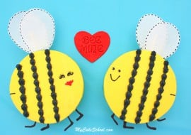 So much cuteness! These adorable Bee Mine cakes and cupcakes are perfect for Valentine's Day! Free tutorial by MyCakeSchool.com!