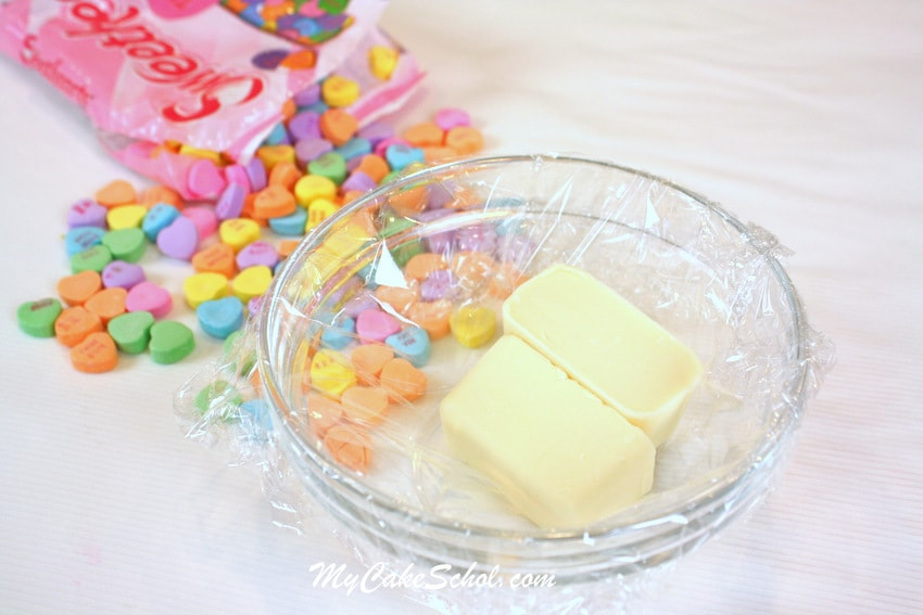 CUTE Conversation Heart Flowers for Cupcakes! Perfect for Valentine's Day! Free tutorial by My Cake School.