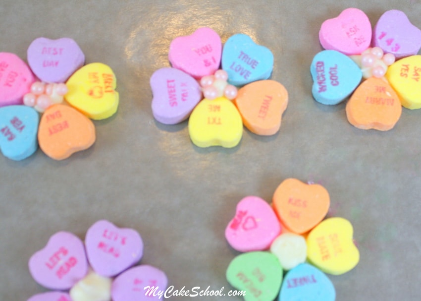 Learn how to make CUTE Conversation Heart Flowers for Cupcakes! Free Cupcake Tutorial for Valentine's Day! MyCakeSchool.com.