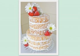 A fabulous twist on the naked cake! This semi dressed naked cake is dressed only in delicate buttercream scrollwork. MyCakeSchool.com.
