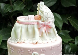 Elegant baby bassinet cake topper! Tutorial by MyCakeSchool.com. Learn cake decorating online!