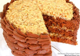 The BEST German Chocolate Cake recipe from scratch! Moist German chocolate cake layers with a flavorful coconut pecan filling! MyCakeSchool.com online cake tutorials, recipes, videos, and more!