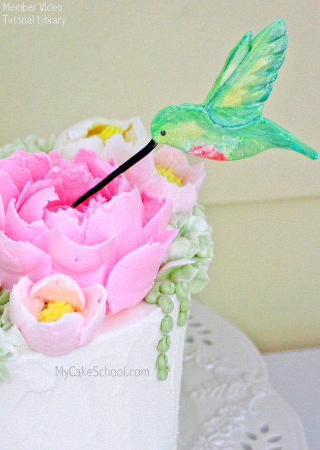 Hummingbird Cake Topper Tutorial with fluffy frosting flowers! MyCakeSchool.com