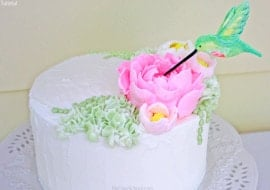 Beautiful Hummingbird Cake Topper Tutorial with Large Frosting Flowers! Video Tutorial by MyCakeSchool.com!