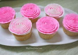 Learn how to pipe gorgeous buttercream ribbon roses onto cupcakes in this free MyCakeSchool.com cake decorating video tutorial! Perfect for all skill levels!