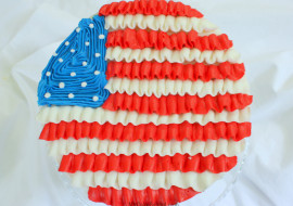 Learn how to make a Ruffled Flag Cake in Buttercream for July 4th! Free cake tutorial by MyCakeSchool.com!