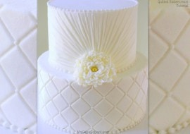Learn how to make quilted buttercream and buttercream ruching in this elegant cake video tutorial by MyCakeSchool.com!