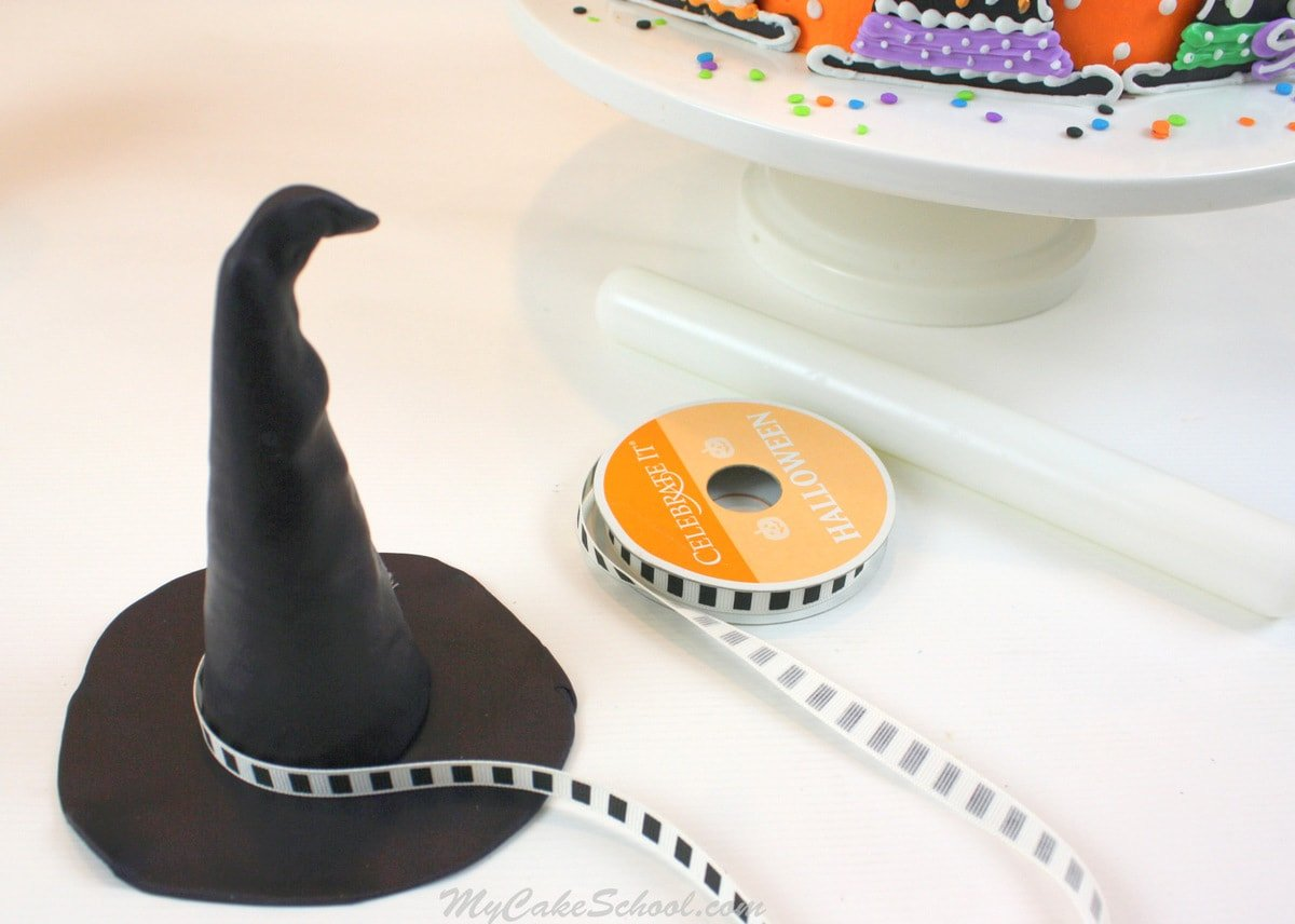 Learn to make a witch hat cake topper and witch hat cake decorations in this free MyCakeSchool.com cake tutorial!