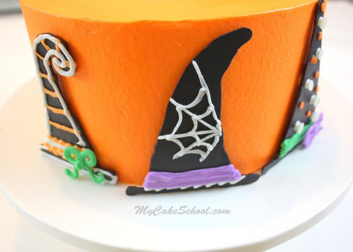 Adorable Free Halloween Cake Tutorial by MyCakeSchool.com, featuring witch hat decorations! Perfect for Halloween parties!