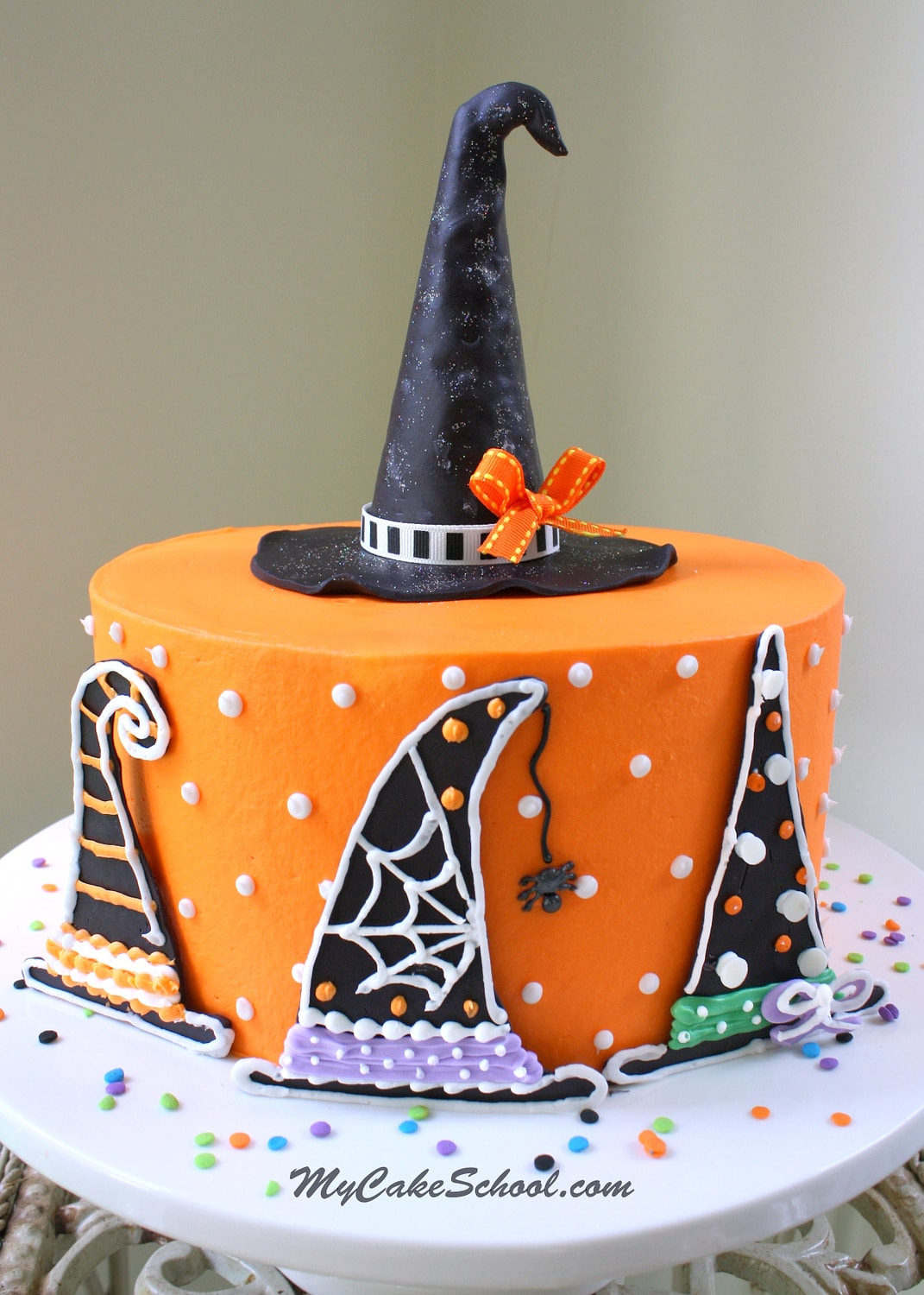 Learn how to make a Witch Hat themed cake in this CUTE and free cake tutorial by MyCakeSchool.com! PERFECT for Halloween Parties!
