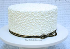 How to Pipe Elegant Cornelli Lace- A Cake Decorating Tutorial by MyCakeSchool.com